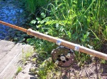 Picture of a Mark IV vintage split cane fishing rod with centre pin fishing reel