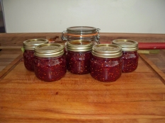 Picture of six jars of raspberry jam