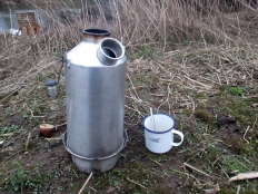 Picture of a Kelly Kettle and a mug