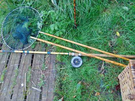 Picture of an Edgar Sealey fishing rod, vintage landing net and wicker creel