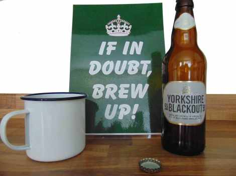 Picture of a sign that reads - If in doubt, brew up. Next to a mug of tea and a bottle of Yorkshire blackout ale