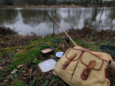 Picture of fishing rod in its rod rest with Brady bag and a box of maggots