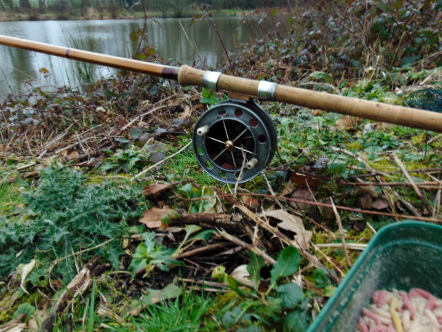 Picture of a Fred J Taylor fishing rod with Allcocks Aerial fishing reel sitting in a rod rest