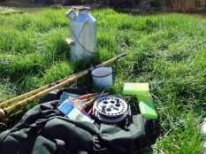 Picture of fishing equipment. Rod, reel, floats and my Kelly Kettle.