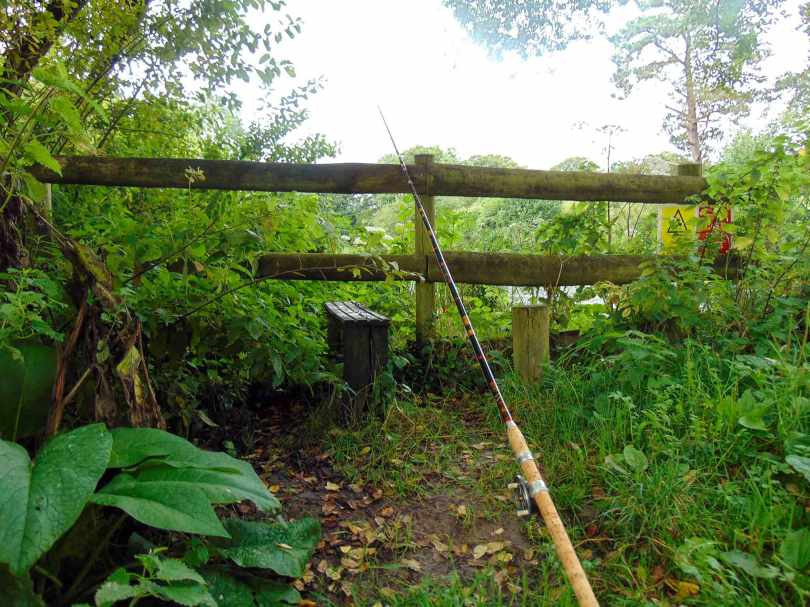 Picture of an R Sealey Match Winner cane fishing rod rest up against a wooden fence